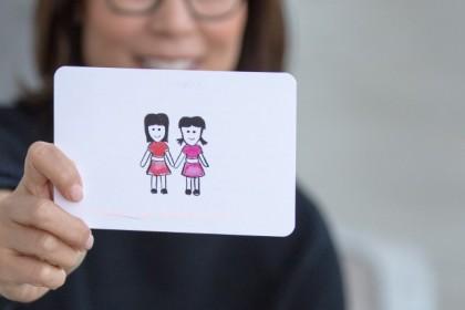 holding emoji card