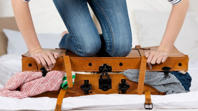 smoosh the suitcase